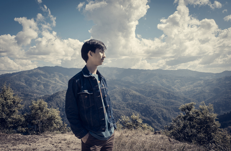aisa: aisa man at outdoor on top of mountain with retro filter