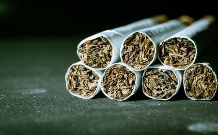 vices: Close up Tobacco Cigarettes pattern with retro filter Stock Photo