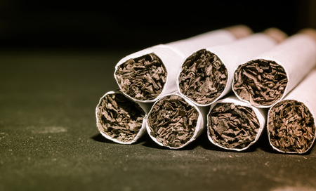 Close up Tobacco Cigarettes pattern with retro filter Stock Photo