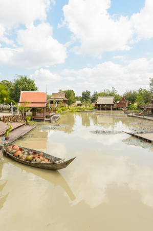 thai style: lake nature with old asia house villager