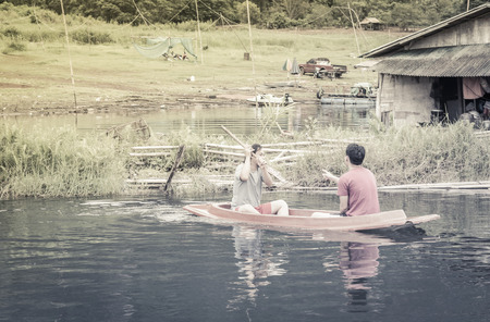 jacked: asia two men driving with kayak on natural forest river (water sport) with retro filter