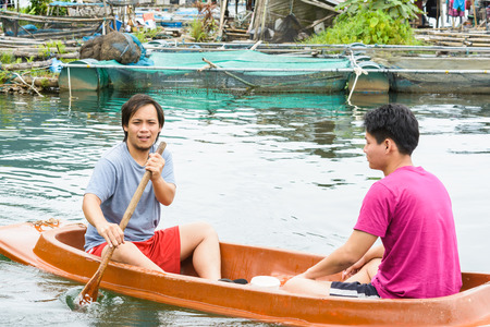 jacked: asia two men driving with kayak on natural forest river (water sport)