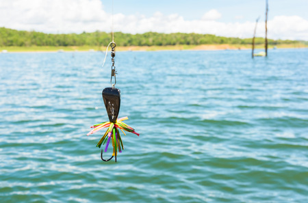 bob: spinner for fishing (fishing bob) on river natural dam