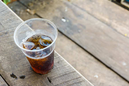 Cola ice Drink with on a wood table Stock Photo