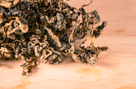 loose leaf: organic loose tea leaf for drink on wood table background with retro filter Stock Photo