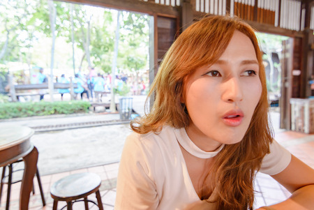 portrait asia Beautiful girl rest and sitting in cafe. Stock Photo