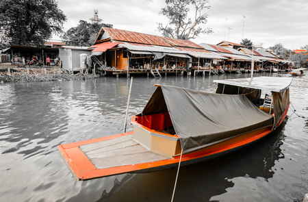 Thai home and boat at riverside old village in Thailand with retro vintage filter