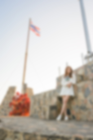 blur background of people woman at outdoor with flag pole thailand Standard-Bild