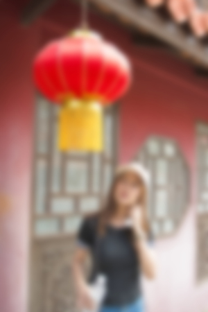 blur background of people travel man in home asia chinese style indoor.