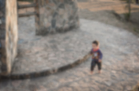 blur background of child run and play on play park outdoor