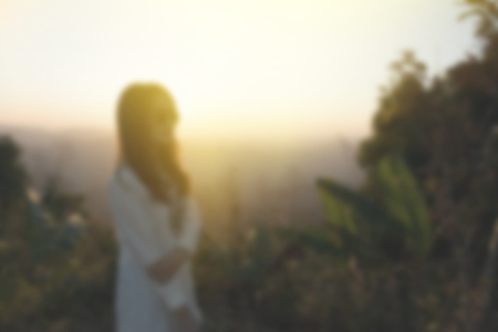 blur background of woman alone on natural mountain outdoor