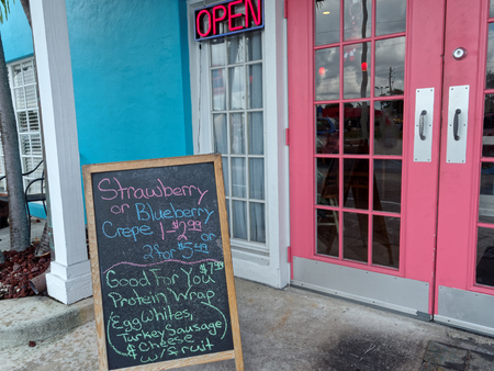 quaint: Quaint diner with bright tropical colors of pink and blue