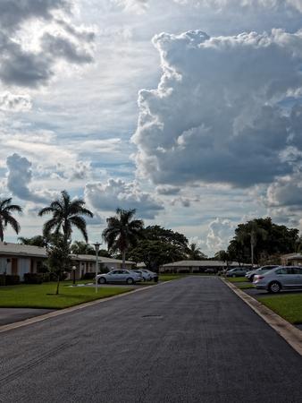 residential street: Dramatic skies over residential street