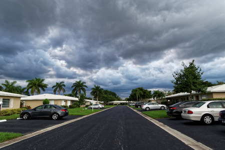 storm coming: Empty residential street on overcast day with storm coming in Stock Photo