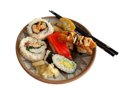 philadelphia roll: A plate of sushi with chopsticks
