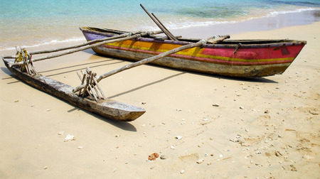 rigger: Polynesian out-rigger canoe on the beach