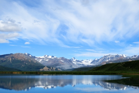 mountain lake blue sky at alaska photo