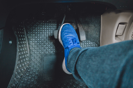 The gas pedal brake pedal on the blue shoes.