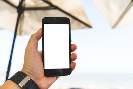 hand on smartphone Concept travel on vacation