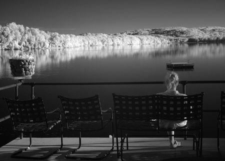 Reading on the Veranda by the Lake                          Stok Fotoğraf