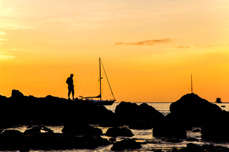 Silhouette with color of the sunset Yanuy beachName thai  Phuket Thailand photo