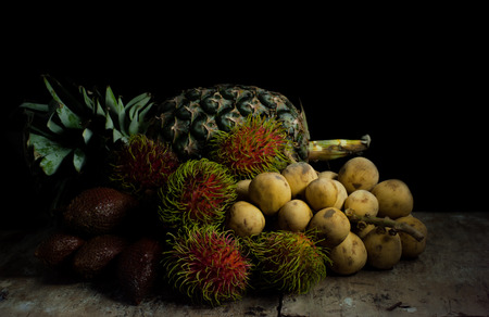 abstract fruit: Abstract fruit still life concept for wine tasting or harvest vineyard on black background Stock Photo