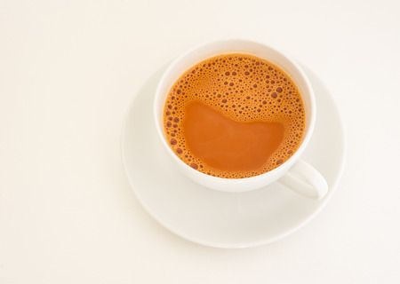 Hot milk tea in cup on white background