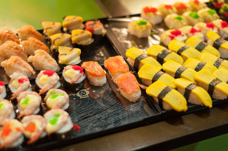 hashi: Sushi set in a kitchen board, Sushi collection Stock Photo