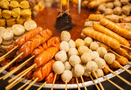 Asia style fried sausage sticks as a popular street food