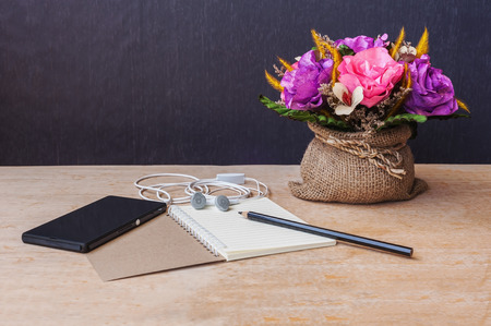 composer: Pencil with paper and headphone and smartphone on wooden table still life tone, Table of composer Stock Photo