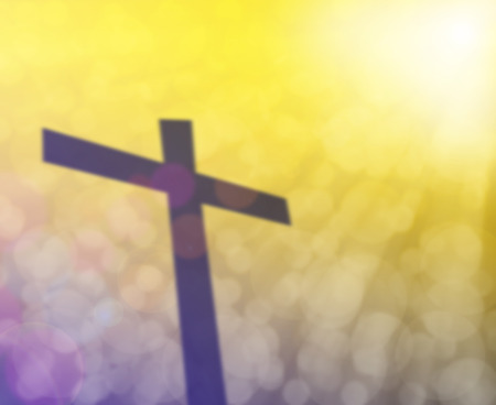 golgotha: Cross and colorful light bokeh with light flare blurred background