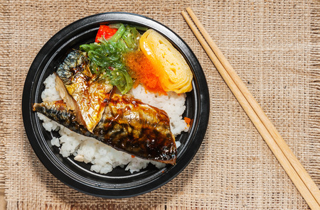 food still: Japanese food style , Saba fish grilled set with rice on cloth background in still life style Stock Photo