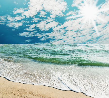white sand beach: Blue sea with white sand beach and cloud sky background