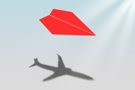 aspirations: Paper airplane casting shadow of a jetliner - Vision and aspirations concept Stock Photo