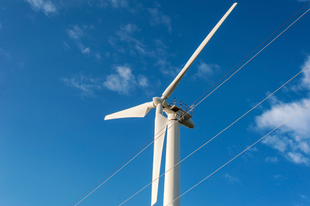 windy energy: Wind Energy Blows Into Future Amarillo And Turbine Farms On Blue Sky Background