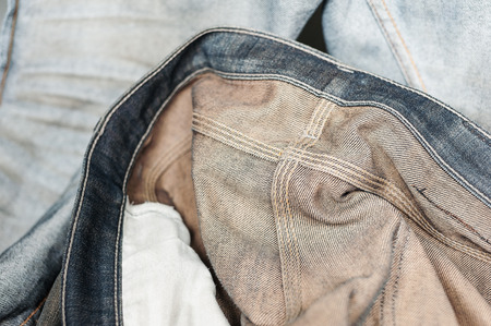 inside out: Close up blue jean or denim inside out, Grunge denim or blue jeans texture, Blue denim that can be used as product, Selective focus