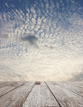 nimbi: Wooden table top on blue sky with cloud, Blue sky and white cloud textue with pattern, Frame of blue sky and texture with pattern of white cloud for design, Can be use for display or montage you product