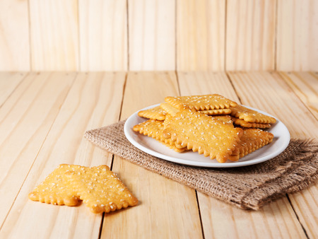 sesame cracker: Stacked Butter Biscuits with sesame on wooden background