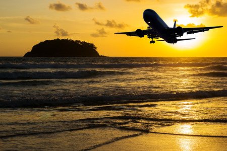 Beach with plane on color of the sunset in twilight over light the sun Stock Photo