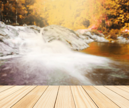 caes: Wood table top on blurred colorful water fall, Can be used for display or montage you product