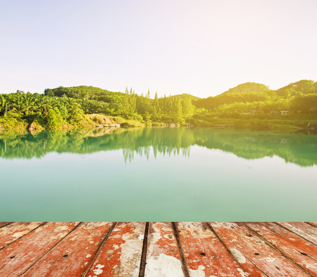 Wood floor top on river with green tree in nature Stock Photo