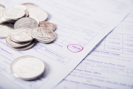 expenditure: Save money concept, Bill and coins on office table, Bill for income and expenditure