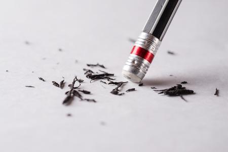 Eraser and error concept, Change concept, Black pencil with black eraser on white background, Mistake erase concept