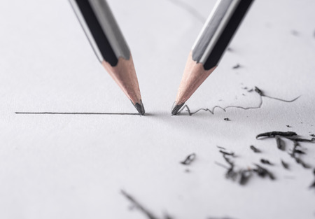 residue: Mistake concept, Close up of a sharpened pencil writing a straight line Stock Photo