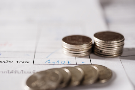Utility bill with silver coins save money and account banking and finance for prepare concept Stock Photo