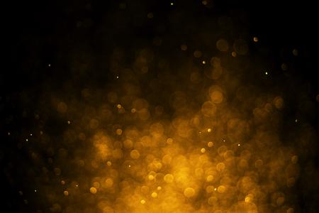 glitter light bokeh gold blurred black background