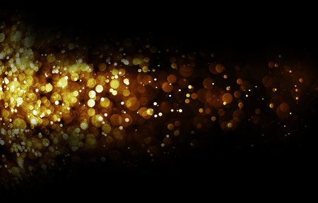 Bokeh light color gold blurred black background  Stock Photo