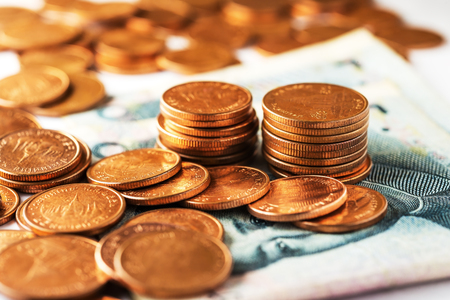 Saving money and account finance bank business concept, Gold coin on currency