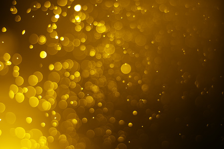 Bokeh light gold color blurred on black background