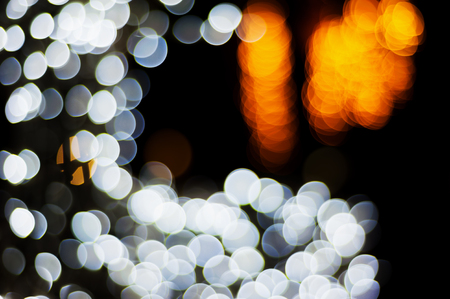 Bokeh christmas light night abstract colorful blurred on black background Stock Photo